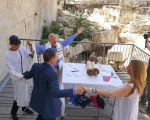 Zak, the Bar Mitzvah boy and parents celebrate with the Rabbi. Mazel Tov!